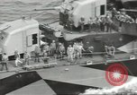 Image of Wounded transferred, ship-to-ship, on Stokes stretcher Mariana Islands, 1944, second 38 stock footage video 65675062229