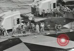 Image of Wounded transferred, ship-to-ship, on Stokes stretcher Mariana Islands, 1944, second 39 stock footage video 65675062229