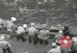 Image of Wounded transferred, ship-to-ship, on Stokes stretcher Mariana Islands, 1944, second 40 stock footage video 65675062229