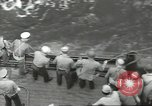 Image of Wounded transferred, ship-to-ship, on Stokes stretcher Mariana Islands, 1944, second 41 stock footage video 65675062229