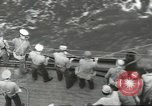 Image of Wounded transferred, ship-to-ship, on Stokes stretcher Mariana Islands, 1944, second 42 stock footage video 65675062229