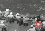 Image of Wounded transferred, ship-to-ship, on Stokes stretcher Mariana Islands, 1944, second 43 stock footage video 65675062229