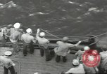 Image of Wounded transferred, ship-to-ship, on Stokes stretcher Mariana Islands, 1944, second 44 stock footage video 65675062229