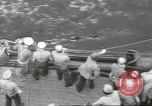 Image of Wounded transferred, ship-to-ship, on Stokes stretcher Mariana Islands, 1944, second 45 stock footage video 65675062229