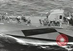 Image of Wounded transferred, ship-to-ship, on Stokes stretcher Mariana Islands, 1944, second 46 stock footage video 65675062229