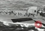 Image of Wounded transferred, ship-to-ship, on Stokes stretcher Mariana Islands, 1944, second 47 stock footage video 65675062229