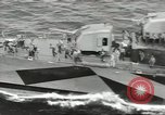 Image of Wounded transferred, ship-to-ship, on Stokes stretcher Mariana Islands, 1944, second 50 stock footage video 65675062229