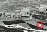 Image of Wounded transferred, ship-to-ship, on Stokes stretcher Mariana Islands, 1944, second 51 stock footage video 65675062229