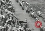Image of Wounded transferred, ship-to-ship, on Stokes stretcher Mariana Islands, 1944, second 52 stock footage video 65675062229