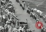 Image of Wounded transferred, ship-to-ship, on Stokes stretcher Mariana Islands, 1944, second 53 stock footage video 65675062229