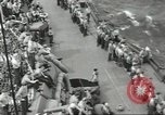 Image of Wounded transferred, ship-to-ship, on Stokes stretcher Mariana Islands, 1944, second 55 stock footage video 65675062229
