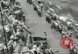 Image of Wounded transferred, ship-to-ship, on Stokes stretcher Mariana Islands, 1944, second 56 stock footage video 65675062229