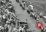 Image of Wounded transferred, ship-to-ship, on Stokes stretcher Mariana Islands, 1944, second 58 stock footage video 65675062229