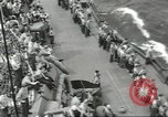 Image of Wounded transferred, ship-to-ship, on Stokes stretcher Mariana Islands, 1944, second 59 stock footage video 65675062229