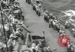 Image of Wounded transferred, ship-to-ship, on Stokes stretcher Mariana Islands, 1944, second 60 stock footage video 65675062229