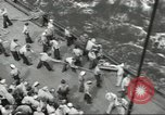 Image of Wounded transferred, ship-to-ship, on Stokes stretcher Mariana Islands, 1944, second 61 stock footage video 65675062229