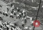 Image of Wounded transferred, ship-to-ship, on Stokes stretcher Mariana Islands, 1944, second 62 stock footage video 65675062229