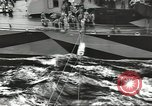 Image of Transferring wounded between ships on Stokes stretcher Mariana Islands, 1944, second 4 stock footage video 65675062231