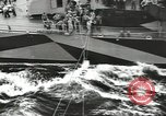 Image of Transferring wounded between ships on Stokes stretcher Mariana Islands, 1944, second 6 stock footage video 65675062231