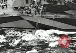 Image of Transferring wounded between ships on Stokes stretcher Mariana Islands, 1944, second 7 stock footage video 65675062231