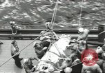 Image of Transferring wounded between ships on Stokes stretcher Mariana Islands, 1944, second 8 stock footage video 65675062231