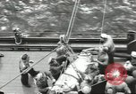 Image of Transferring wounded between ships on Stokes stretcher Mariana Islands, 1944, second 9 stock footage video 65675062231