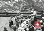 Image of Transferring wounded between ships on Stokes stretcher Mariana Islands, 1944, second 10 stock footage video 65675062231