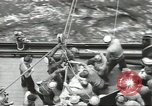 Image of Transferring wounded between ships on Stokes stretcher Mariana Islands, 1944, second 11 stock footage video 65675062231