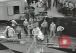 Image of Transferring wounded between ships on Stokes stretcher Mariana Islands, 1944, second 20 stock footage video 65675062231