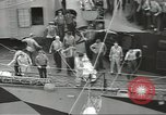 Image of Transferring wounded between ships on Stokes stretcher Mariana Islands, 1944, second 21 stock footage video 65675062231