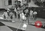Image of Transferring wounded between ships on Stokes stretcher Mariana Islands, 1944, second 22 stock footage video 65675062231