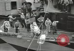 Image of Transferring wounded between ships on Stokes stretcher Mariana Islands, 1944, second 25 stock footage video 65675062231
