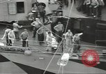 Image of Transferring wounded between ships on Stokes stretcher Mariana Islands, 1944, second 27 stock footage video 65675062231