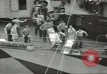 Image of Transferring wounded between ships on Stokes stretcher Mariana Islands, 1944, second 29 stock footage video 65675062231