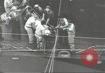 Image of Transferring wounded between ships on Stokes stretcher Mariana Islands, 1944, second 30 stock footage video 65675062231