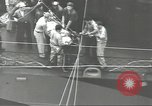 Image of Transferring wounded between ships on Stokes stretcher Mariana Islands, 1944, second 31 stock footage video 65675062231