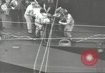 Image of Transferring wounded between ships on Stokes stretcher Mariana Islands, 1944, second 32 stock footage video 65675062231