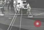Image of Transferring wounded between ships on Stokes stretcher Mariana Islands, 1944, second 36 stock footage video 65675062231