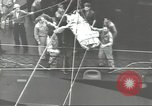 Image of Transferring wounded between ships on Stokes stretcher Mariana Islands, 1944, second 40 stock footage video 65675062231