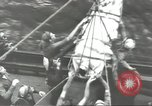 Image of Transferring wounded between ships on Stokes stretcher Mariana Islands, 1944, second 45 stock footage video 65675062231