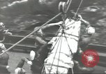Image of Transferring wounded between ships on Stokes stretcher Mariana Islands, 1944, second 46 stock footage video 65675062231