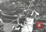 Image of Transferring wounded between ships on Stokes stretcher Mariana Islands, 1944, second 47 stock footage video 65675062231