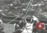 Image of Transferring wounded between ships on Stokes stretcher Mariana Islands, 1944, second 48 stock footage video 65675062231