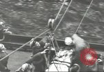 Image of Transferring wounded between ships on Stokes stretcher Mariana Islands, 1944, second 49 stock footage video 65675062231