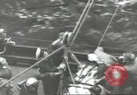 Image of Transferring wounded between ships on Stokes stretcher Mariana Islands, 1944, second 50 stock footage video 65675062231