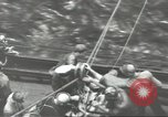 Image of Transferring wounded between ships on Stokes stretcher Mariana Islands, 1944, second 52 stock footage video 65675062231