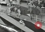 Image of Transferring wounded between ships on Stokes stretcher Mariana Islands, 1944, second 62 stock footage video 65675062231