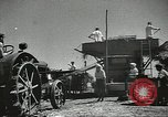 Image of Soviet farmers cutting and threshing stalks of grain during World War 2 Soviet Union, 1941, second 16 stock footage video 65675062264
