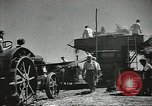 Image of Soviet farmers cutting and threshing stalks of grain during World War 2 Soviet Union, 1941, second 17 stock footage video 65675062264
