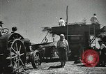 Image of Soviet farmers cutting and threshing stalks of grain during World War 2 Soviet Union, 1941, second 18 stock footage video 65675062264